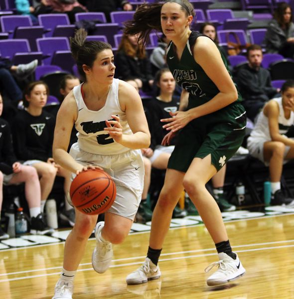 DAN BROOD - Tigard sophomore guard Kennedy Brown (left) looks to dribble past Sheldon's Amber Winkler during Thursday's state tournament game.
