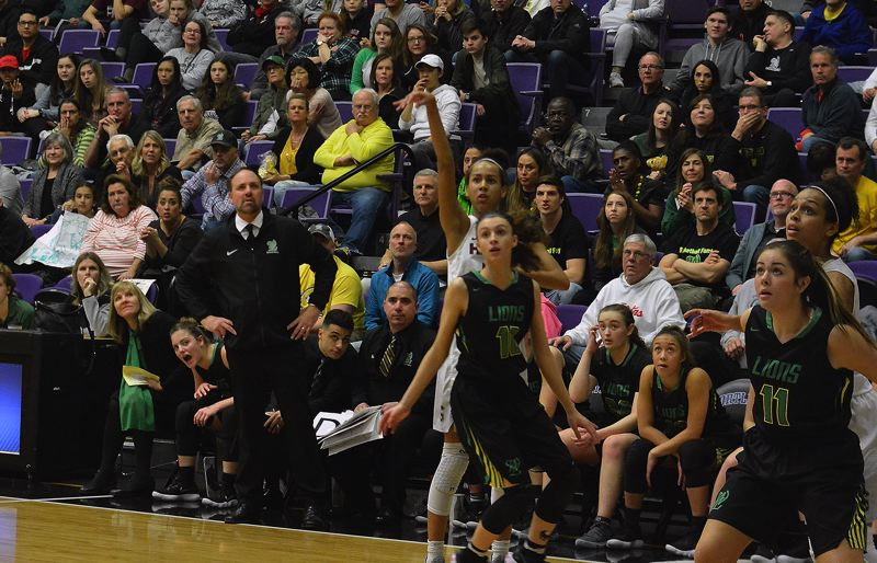 TIMES PHOTO: MATT SINGLEDECKER - Southridge freshman Maya Hoff watches a three-pointer sink through the net against West Linn.