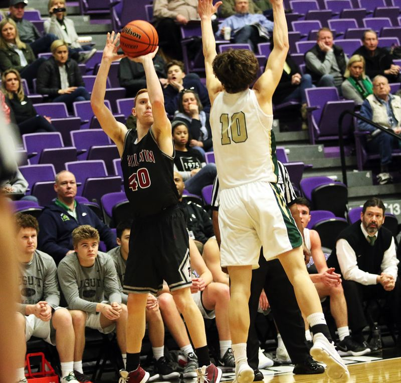 DAN BROOD  - Tualatin junior Jack Rose (left) shoots over Jesuit's Matthew Levis during the first half of Friday's game.