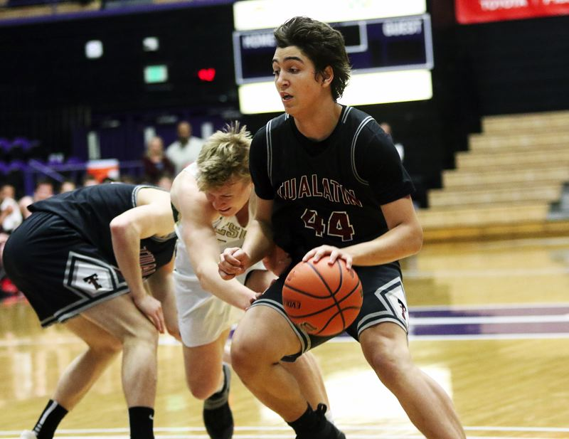 DAN BROOD - Tualatin junir Bridger Steppe drives with the ball during Friday's Class 6A state tournament game.