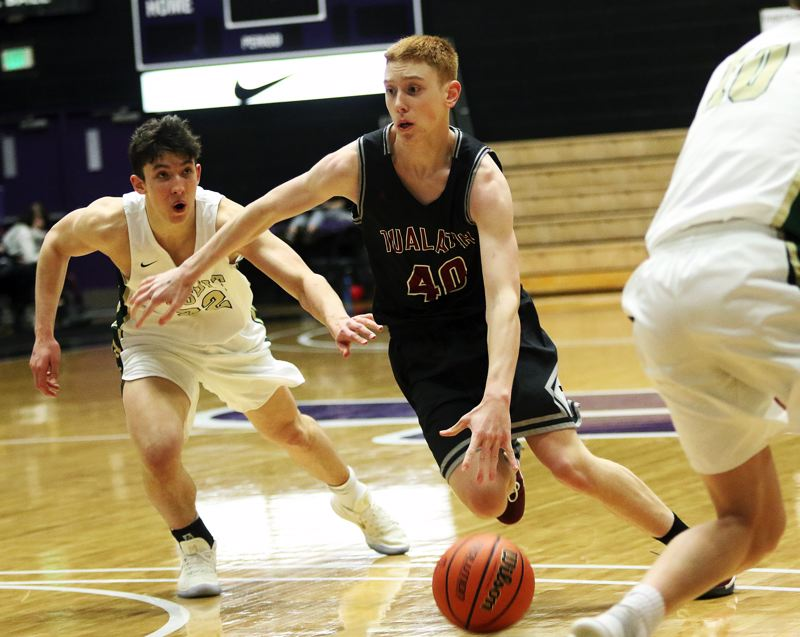 DAN BROOD - Tualatin junior Jack Rose puts the ball on the court as he looks to drive to the basket during the victory over Jesuit.
