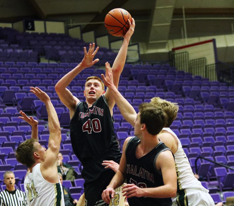 DAN BROOD - Tualatin junior Jack Rose goes up high to put up a shot during the Wolves' victory over Jesuit.