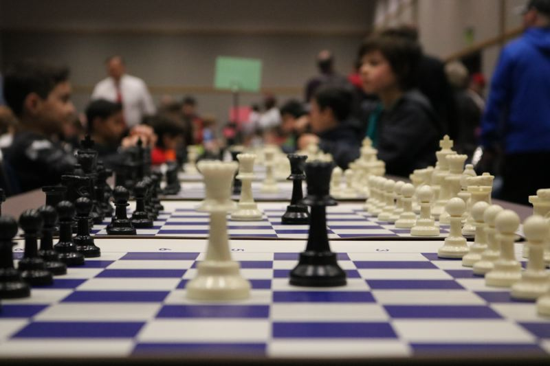 TRIBUNE PHOTO: ZANE SPARLING - Elementary students prepare to play during the annual Chess for Success tournament at the Oregon Convention Center in Portland on Saturday, March 10.