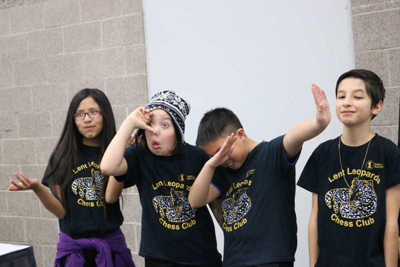 TRIBUNE PHOTO: ZANE SPARLING - Students from the Lent Leopards Chess Club strike a goofy pose.
