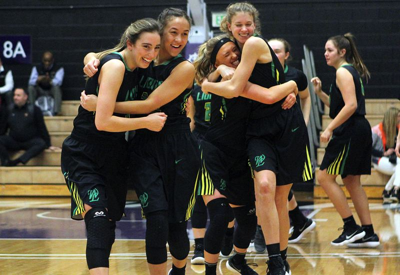 TIDINGS PHOTO: MILES VANCE - West Linn's (from left) Lexie Pritchard, Payton Shelstad, Brooke Landis and Alyx Burkhartzmeyer share hugs at the end of their 38-33 win over Beaverton in the third-place game of the Class 6A state tournament at the Chiles Center on Saturday.