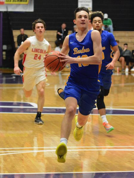OUTLOOK PHOTO: DAVID BALL - Barlow's Evan Inglesby closes in on the basket during a fastbreak in the first half.