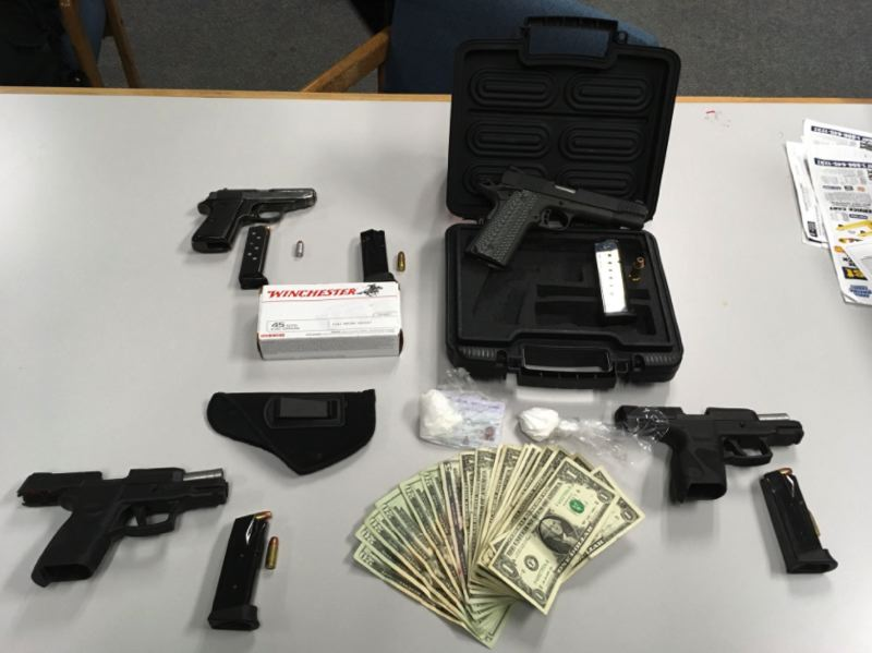 GRESHAM POLICE PHOTO - Gresham police say they recovered four handguns, cash and cocaine during a traffic stop on Saturday, March 10.