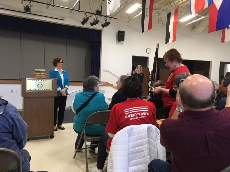 PAMPLIN MEDIA GROUP: PETER WONG - U.S. Rep. Suzanne Bonamici, D-Ore., hears a question from Lisa Li of Beaverton about the prospects of federal research into gun violence during a town hall meeting Saturday, March 10, at Conestoga Middle School in Beaverton.