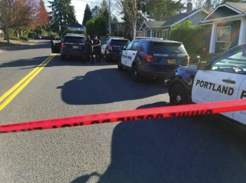(Image is Clickable Link) KOIN 6 NEWS PHOTO - A large police presence gathered around a residential burglary in Southeast Portland on March 11, 2018.