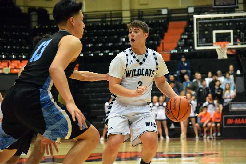 SPOKESMAN PHOTO: TANNER RUSS - Junior Jack Roche was one of the many dangerous shooters that Wilsonville had heading into the playoffs. Against Thurston in the finals, however, Roche was held to just five points.
