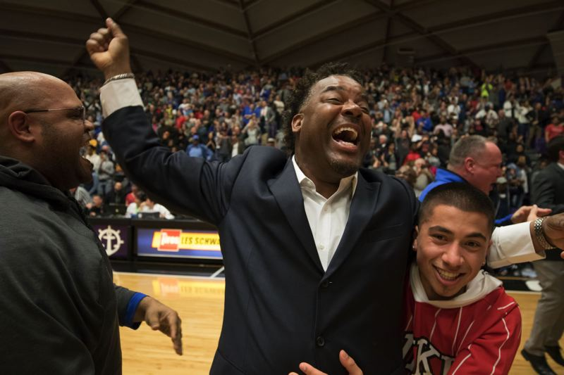 TRIBUNE PHOTO: JONATHAN HOUSE - Grant coach Robert Key reacts after his team prevailed by one point in an all-Portland Interscholastic League state championship game.