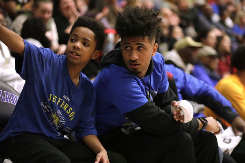 TRIBUNE PHOTO: JONATHAN HOUSE - Jefferson High basketball standout Marcus Tsohonis (right), the PIL player of the year, couldn't compete in the state tournament because of a broken finger.