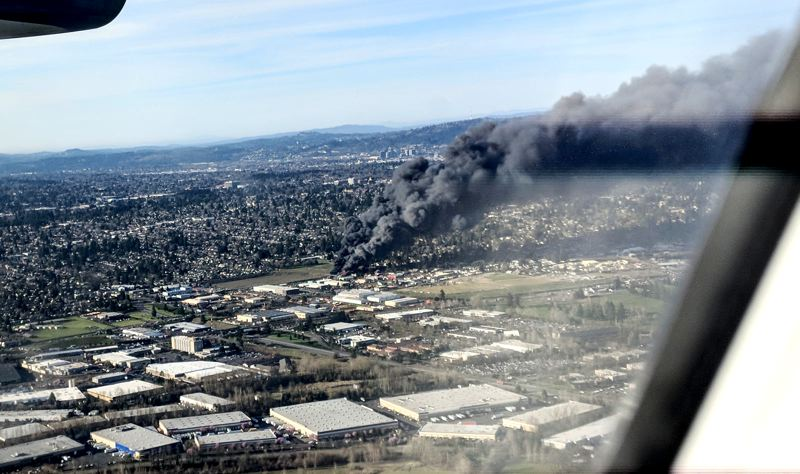 COURTESY PHOTO: KRIS AMUNDSON - The Northeast 75th Avenue fire could be seen by airline passengers arriving Monday at Portland International Airport.