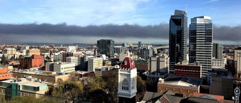 COURTESY PHOTO: KATY KING - Smoke from the Northeast 75th Avenue fire hung on the horizon near downtown Portland most of Monday morning.