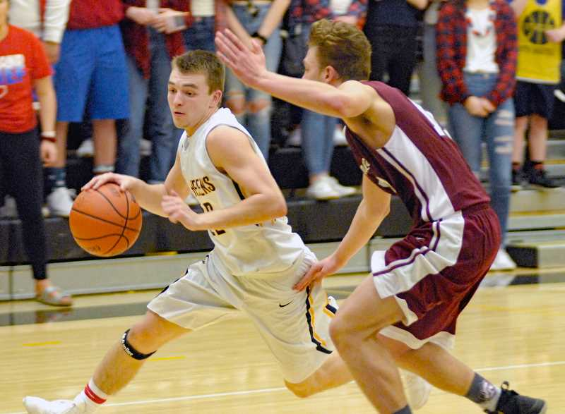 SPOTLIGHT FILE PHOTO - Point guard Drake Dow served as 'the driving force' for St. Helens boys basketball, says coach Jordan Massinger.
