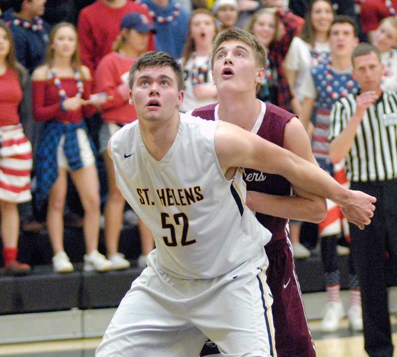 SPOTLIGHT FILE PHOTO - 'If a college that has a great player development program is looking for a player with a super high ceiling, he's their man,' said St. Helens boys basketball coach Jordan Massinger of senior Jacob Falk.