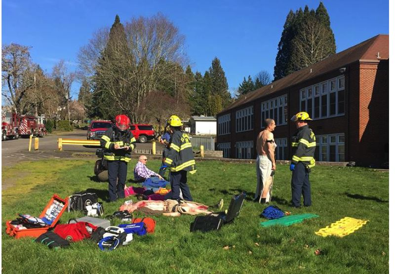 PHOTO COURTESY: CLACKAMAS FIRE - Clackamas firefighter/paramedics provide care to volunteer mock patients outside of Concord Elementary School in Milwaukie.
