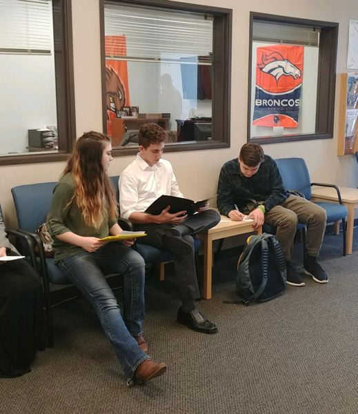 CONTRIBUTED PHOTO: METRO EAST WEB ACADEMY - Metro East Web Academy students Haley Long, Zach Houdage and Andy Bull compare notes while waiting for their mock job interviews.