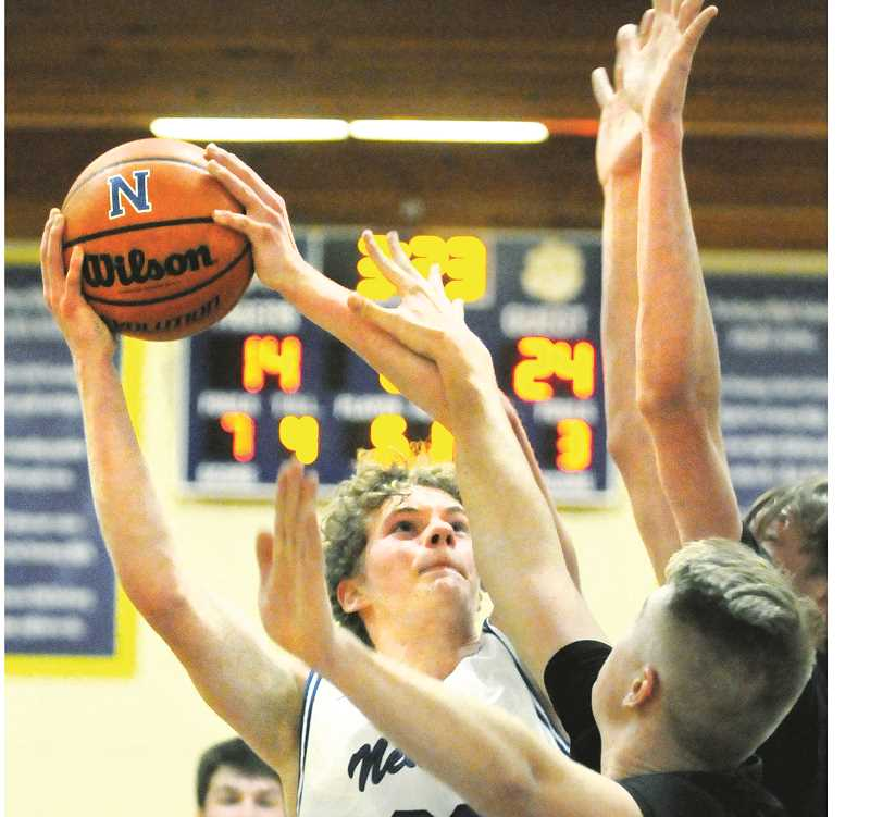 GRAPHIC FILE PHOTO - Newberg forward  Alex Jaczko was named to the All-Three Rivers League first team after a stellar junior season. Sophomore Jack Chlumak and senior Ben O'Loughlin were also named honorable mention.