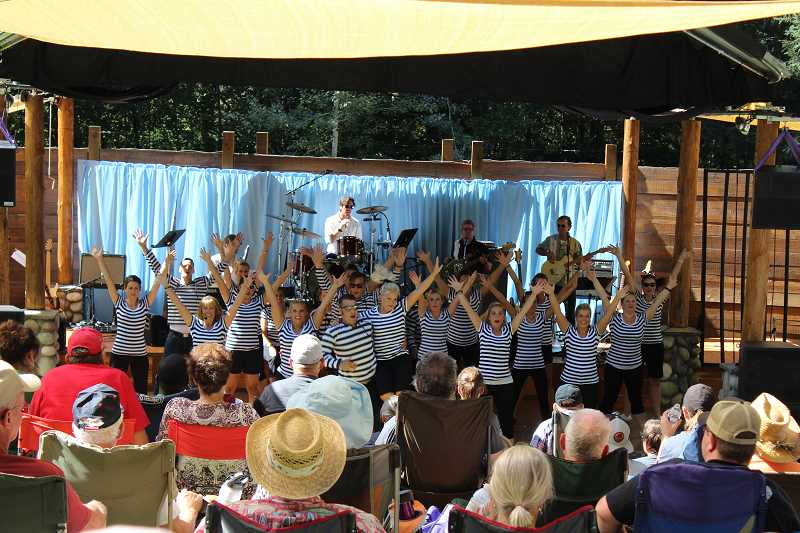 CONTRIBUTED PHOTO: ASPEN MEADOW BAND - Members of the Aspen Meadow Band are triumphant during a previous concert. The band strives to use music to make audiences feel uplifted.