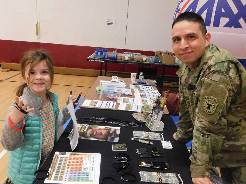 ESTACADA NEWS PHOTO: EMILY LINDSTRAND - River Smith, a student at Summit Learning Charter, and Tony Marquez discuss his career with the U.S. Army during the schools career fair held Thursday, March 8.