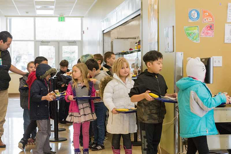 STAFF PHOTO: CHRIS OERTELL - First and second grade students line up during lunchtime at Free Orchards Elementary School in Cornelius which is a Title I school.