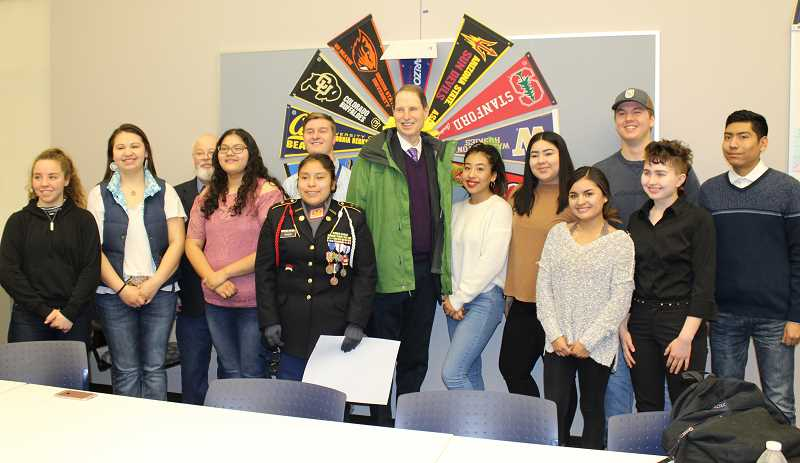 HOLLY M. GILL - Students in Allen Hair's AP Government and Politics class, along with a couple others, met with Sen. Wyden after the town hall. Those gathered included, from left to right, Alesha Freeman, Ellise David, Madras Mayor Royce Embanks, Karina Ramirez, Kira Povis, an unidentified male, U.S. Sen. Ron Wyden, Andrea Vasquez-Morales, Margarita Castellanos, Danira Perez, Jared Holliday, Sierra Cromwell and Willie Poviz.