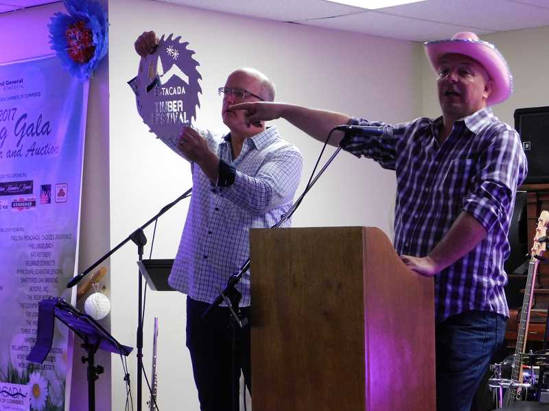 FILE PHOTO - Bob Jones and Aaron Neldner auction off a prize package for the Estacada Timber Festival during last years Spring Gala. This years event is scheduled for Saturday, April 14.