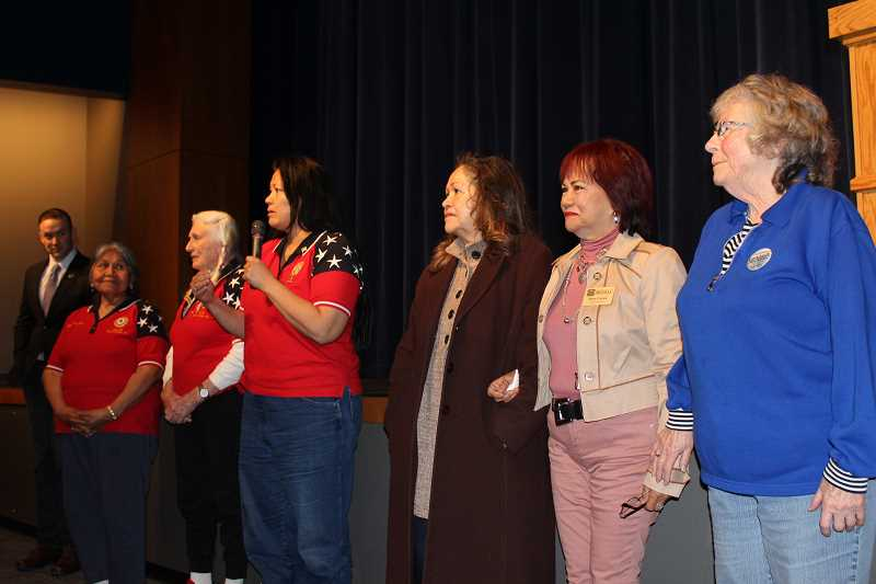 HOLLY M. GILL - Susan Guerin, with microphone, calls forward members of the American Legion and VFW auxiliaries. Pictured from left are Wyden staffer Evan Hessel, Viola Govenor, Gladys Grant, Guerin, Cheryl Lohman, Rose Canga and Scottie Henry.