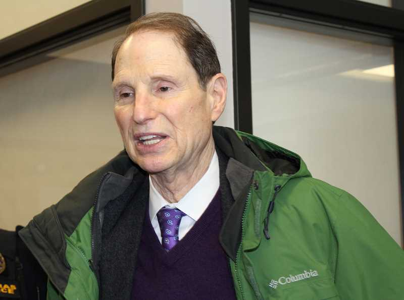HOLLY M. GILL - U.S. Sen. Ron Wyden visits with community members after his March 9 town hall at the Madras Performing Arts Center.