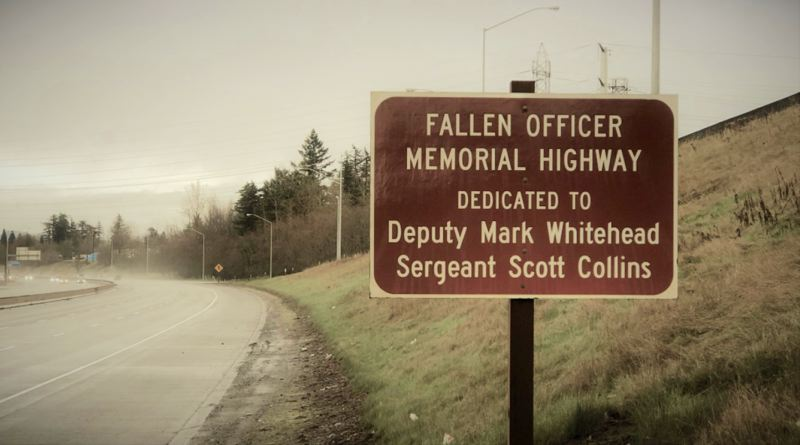 FILE PHOTO - The memorial honors Scott Collins and Mark Whitehead.