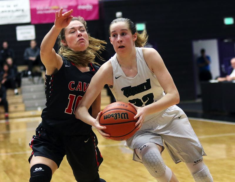 DAN BROOD - Tigard sophomore Delaney Leavitt looks to drive past Clackamas junior Olivia Morris during Saturday's fourth-place game at the Class 6A state tournament. Leavitt scored 18 points in the Tigers' 54-46 victory.