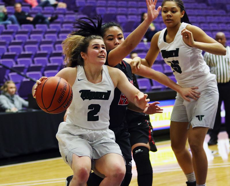 DAN BROOD - Tigard sophomore guard Kennedy Brown (2) drives the baseline during the Tigers' win over Clackamas.