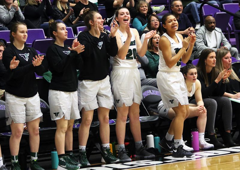 DAN BROOD - Tigard players (from left) Kelsie Boschma, Xandra Britch, Hannah Jedan, Caitlin Erickson and Ajae Kadel cheer on their teammates during Saturday's Class 6A state tournament game.