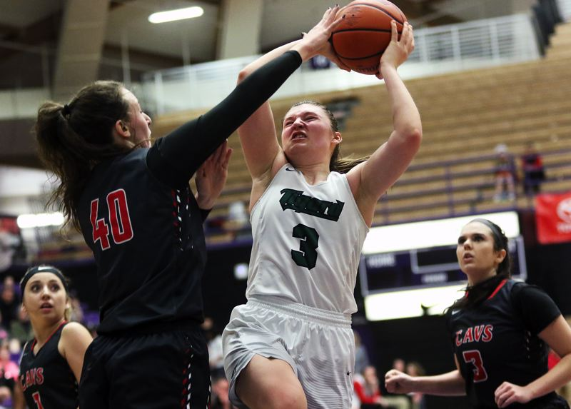 DAN BROOD - Tigard junior Campbell Gray (3) goes up to the basket against Clackamas' Savannah Duarte.