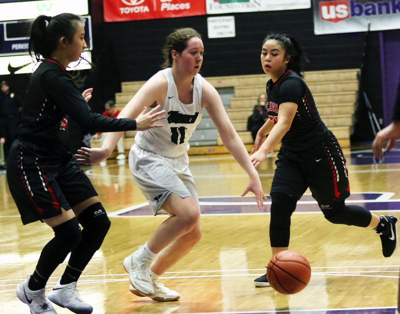 DAN BROOD - Tigard junior guard Paige LaFountain drives between a pair of Clackamas defenders during Saturday's game.