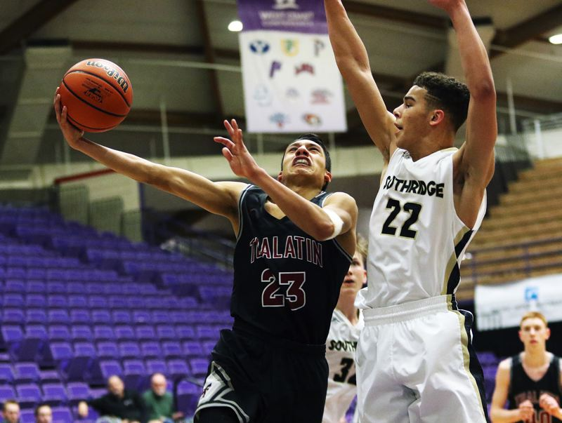 DAN BROOD - Tualatin senior Alexis Angeles (left) goes to the basket against Southridge senior Bo Quinland during Saturday's state tournament. Angeles scored 33 points in the contest.
