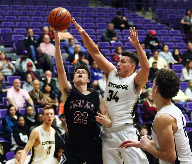 DAN BROOD - Tualatin senior Nathan Platter goes up to the basket as Southridge junior Kade Hustler goes for the block during Saturday's state tournament fourth-place game.