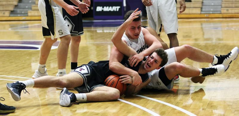 DAN BROOD - Tualatin senior Chris Freese battles Southridge junior Kade Hustler for a loose ball during Saturday's game.