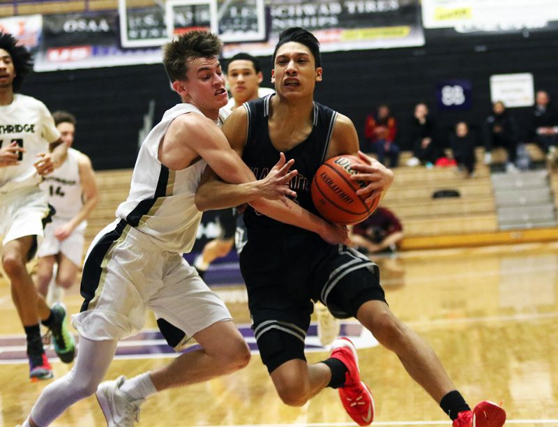 DAN BROOD - Tualatin senior Alexis Angeles (right) is fouled by Southridge senior Connor Fajardo as he tries to drive to the basket during Saturday's state tournament game.