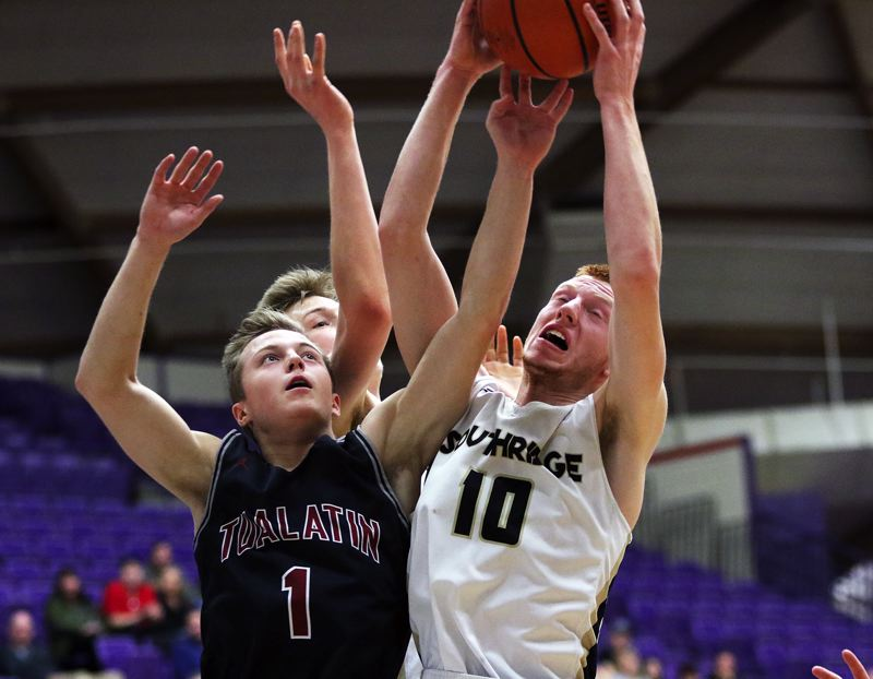 DAN BROOD - Tualatin junior Cade Dickson (1) battles Southridge junior Zach Galvin for a rebound during Saturday's state tournament game.