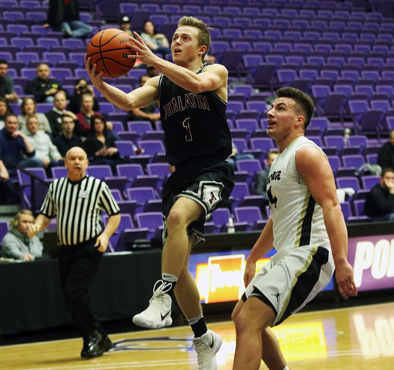 DAN BROOD - Tualatin junior Cade Dickson goes up to the basket in front of Southridge junior Kade Hustler during Saturday's state tournament game.