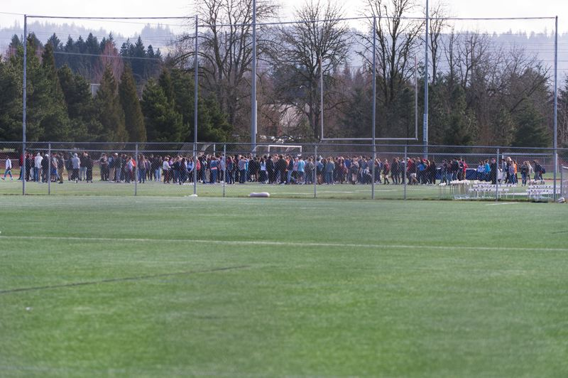 STAFF PHOTO: CHRISTOPHER OERTELL - Students rally outside Liberty High School in Hillsboro on Wednesday during a walkout against gun violence.