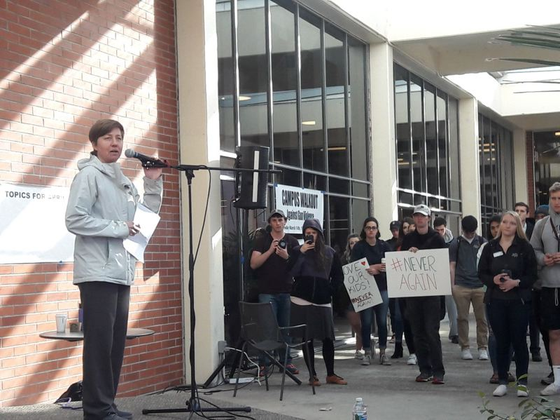STAFF PHOTO: MARK MILLER - Professor Jaye Cee Whitehead, who teaches sociology at Pacific University, addresses students participating in Wednesday's walkout on campus.