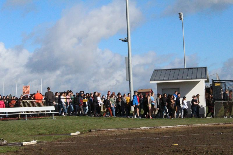 STAFF PHOTO: OLIVIA SINGER - Forest Grove High School students walk outside during an organized student protest against gun violence on Wednesday.