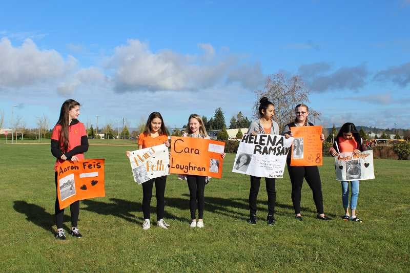 HERALD PHOTO: KRISTEN WOHLERS - On March 14, several students at Baker Prairie held up signs to remember the victims of the Parkland, Florida shooting.