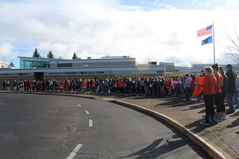 HERALD PHOTO: KRISTEN WOHLERS - Hundreds of Baker Prairie students walked out of their school in complete silence as part of the #Enough National School Walkout March 14.