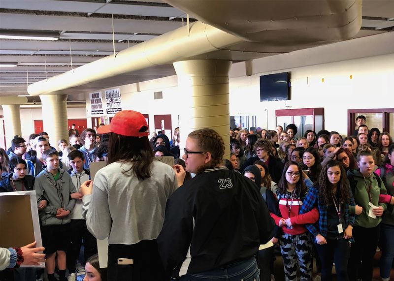 COURTESY PHOTO: PETER WEDLAKE - Students hold a moment of silence at Glencoe High School in Hillsboro after walking out of class Wednesday morning. The 17-minute vigil honored the 17 dead in a school shooting in Parkland, Fla., last month.