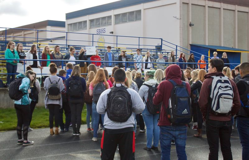 OUTLOOK PHOTO: CHRISTOPHER KEIZUR - Students protest during a 17-minute walk out at Sam Barlow High School on Wednesday, March 14.