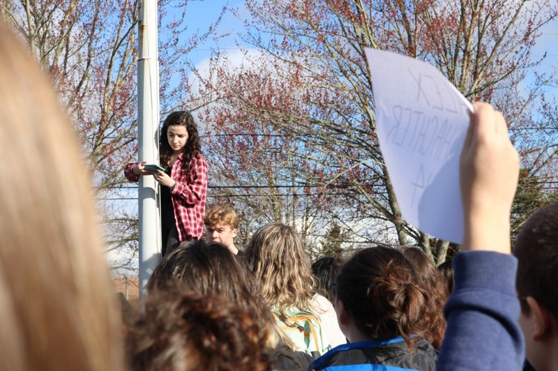 OUTLOOK PHOTO: ZANE SPARLING - Jade Wilson, a junior at Centennial, perched on a flagpole and gave a short speech during the walk out on Wednesday, March 14.